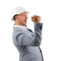 Man wearing a hardhat cheering in jubilation