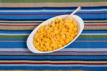 Macaroni and Cheese with Fork on Striped Placemat