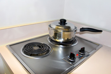 Cooking on the mini electric stove top