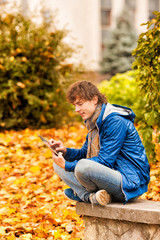 young man with tablet in outdoor