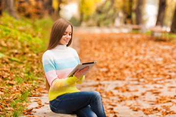 young girl with tablet in outdoor