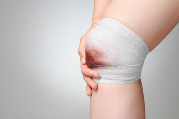 Injured knee with bloody bandage