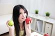 woman sitting enjoing fruits