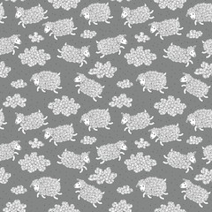 Seamless pattern with cute sheep and clouds.
