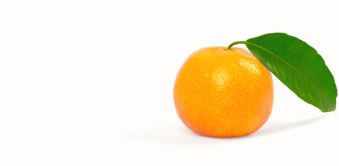 Tangerine with green leaves isolated on white