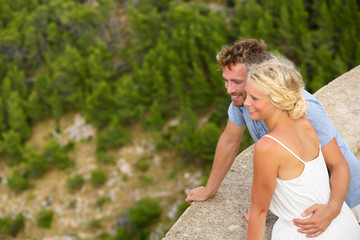 Romantic young beautiful couple looking at view