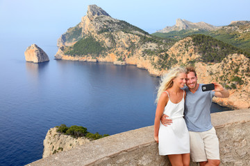Couple taking selfie photo on Formentor Mallorca