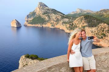 Couple taking selfie photo on Formentor Mallorca