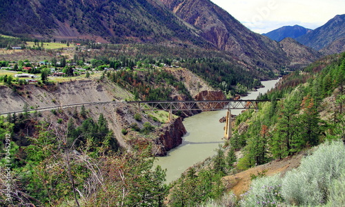 Tuinposter Canyon Railway bridge in the mountains in Lillooet town