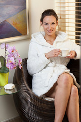 Woman with coffee in spa