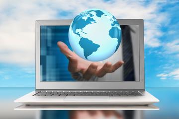 globe in hand through laptop
