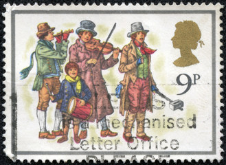 stamp printed in the Great Britain shows musicians