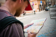 Tourists on the street looking at a map