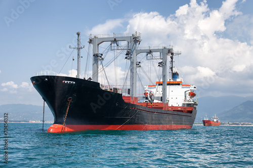 commercial cargo ship on ocean - 70456332