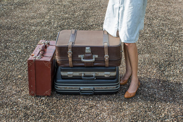 woman traveler with vintage luggage