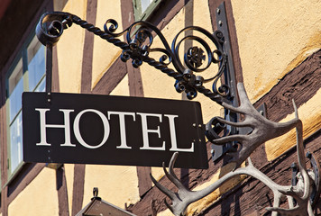 Metal hotel sign