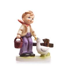 Very old statue, small ceramic boy