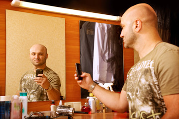 Man photographs herself in the mirror