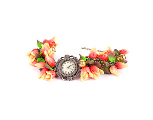 Bright bracelet with flower and watch.