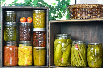 .Jars of home canned vegetables in wooden boxes