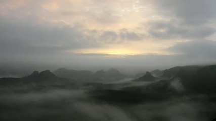 Cold misty night in a fall valley of Saxony Switzerland park.