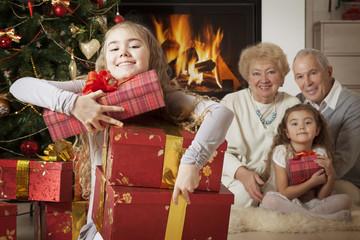 Happy girl getting Christmas presents