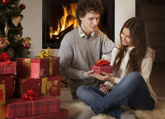 Young couple with Christmas presents