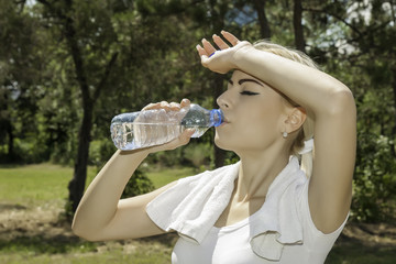 attractive blond woman drinking water
