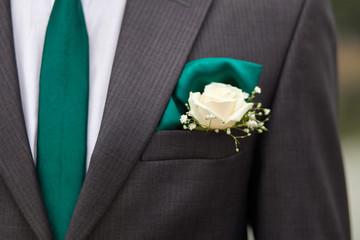 groom jacket with green tie