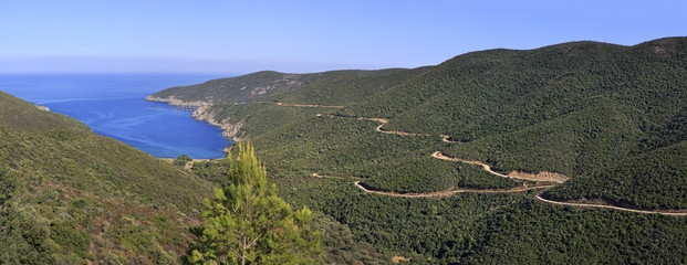 Beautiful panorama of winding mountain road to the bay