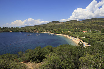 Public beach in the beautiful bay of the Aegean Sea.
