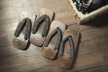 Onsen series : Wooden sandals on wooden floor