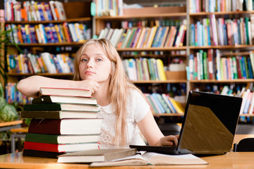 Portrait of a pretty female student in library