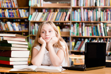 pensive female student in library