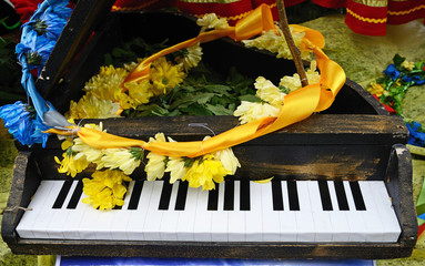 Abstract plot with piano and flower