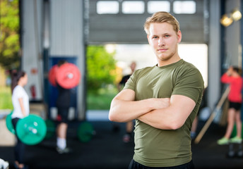 Male Athlete Standing Arms Crossed At Gym