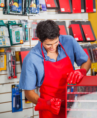 Salesman With Drill Bit And Toolbox In Store