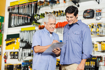 Customers Checking Checklist In Hardware Store