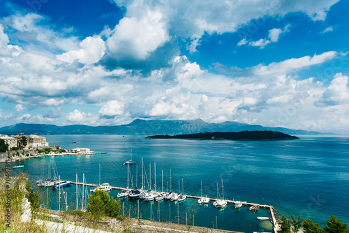 Leinwanddruck Bild Seaside view of greek island of Corfu on a clody summer day