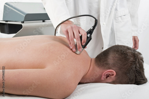 Close-up of laser treatment at physiotherapy - 70468322