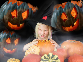 Little witch with pumpkins in the dark