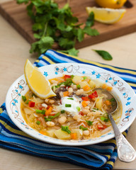 Russian cabbage soup with beans and sour cream