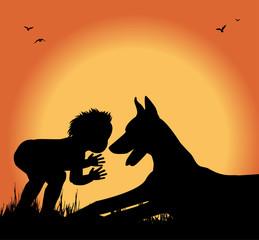 silhouette di bambino e cane in un prato