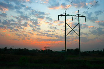 transmission power line on sunset