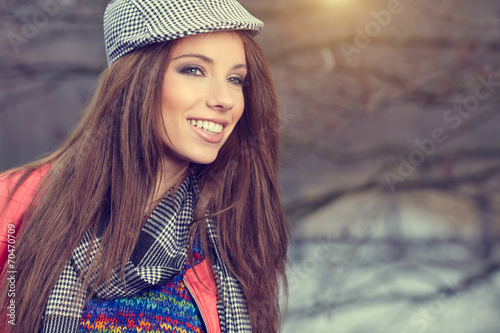 canvas print picture Portrait of a beautiful brunette girl in  in park. Warm sunny da