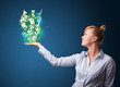Glowing money in the hand of a businesswoman