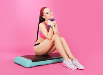 Recreation. Slender Calm Woman with Dumbbells Relaxing