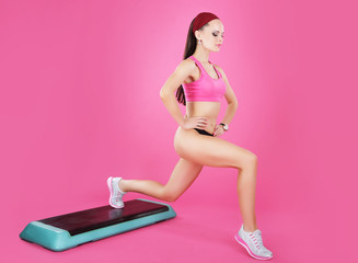 Weight Loss. Active Fit Woman on a Step Exercising