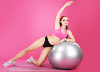 Aerobics. Sporty Woman on Fitness Ball Exercising