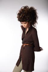 Glamorous Woman in Brown Jacket Looking Down